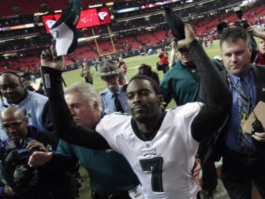 Michael Vick (7) reacts as he comes off the field following a 34-7 win over the Atlanta Falcons in their NFL football game at the Georgia Dome in Atlanta, Sunday, Dec. 6, 2009. (AP Photo/Dave Martin)