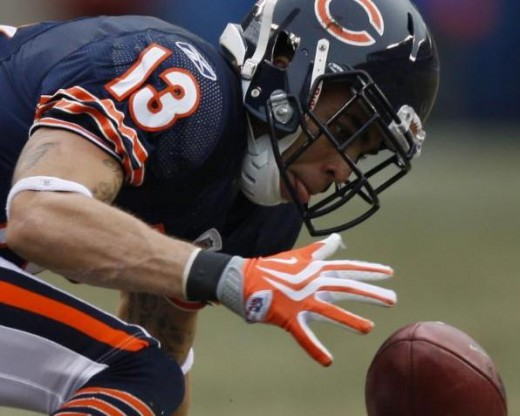 Chicago Bears wide receiver Johnny Knox (13) recovers a dropped punt during the second half of an NFL football game against the St. Louis Ramsin Chicago Sunday, Dec. 6, 2009. (AP Photo/Kiichiro Sato)