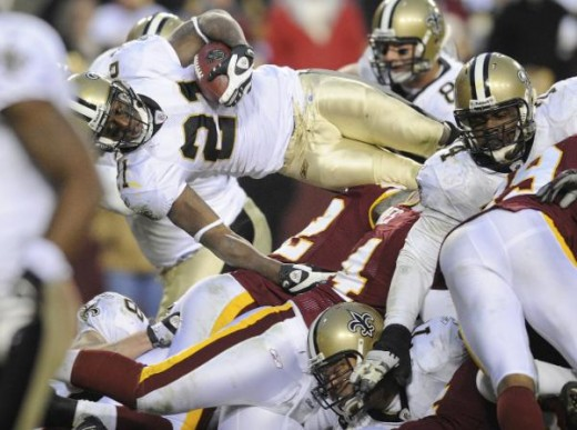 Mike Bell leaps over the line during ovetime in the NFL football game against the Washington Redskins, Sunday, Dec. 6, 2009 in Landover, Md. Bell was landed short of the goal line. The Saints won 33 - 30 in overtime. (AP Photo/Nick Wass)