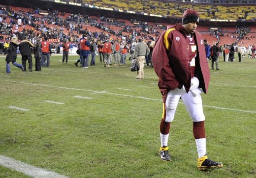 Washington Redskins quarterback Jason Campbell walks off the field after a 33-30 defeat in overtime to the New Orleans Saints in the NFL football game, Sunday, Dec. 6, 2009 in Landover, Md. (AP Photo/Nick Wass)