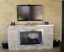 Custom built vent free fireplace with split marble and stainless steel accents.