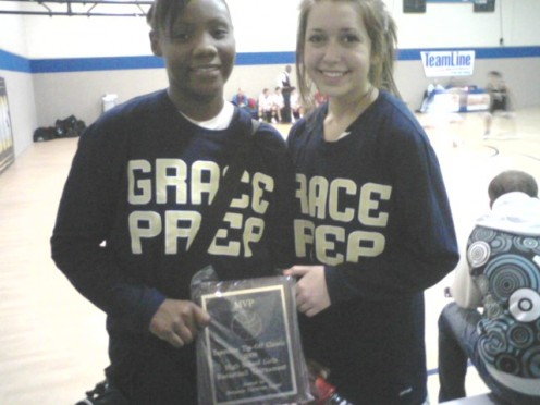 Travia showing off of her MVP awards with one of her team players.