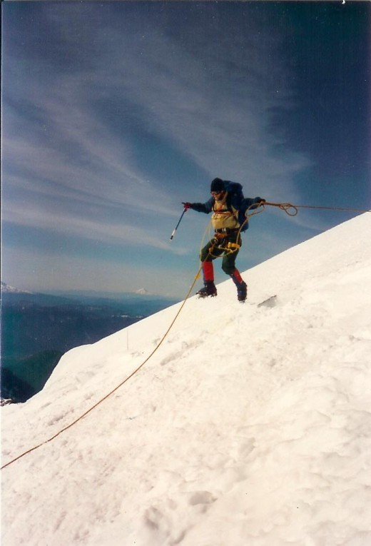 One of Jondolar's team members jumps the cravasse.