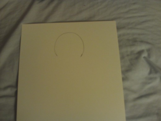 Sketch the head of the gingerbread man onto the cardstock template.