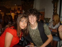 This is a photo of my daughter with Nick Jonas of The Jonas Brothers.
