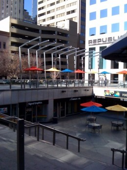 A colorful eating area outside an office building.