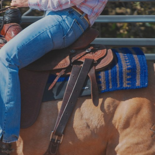 "This is a saddle pad that has a length of 38"".   Notice the length of the saddle pad that is still behind the saddle skirting?  Imagine what it would look like if a barrel (smaller) saddle was on this pad instead."