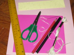 Ruler,scissors,string,pencil,marker,pink and cream color paper, pink manilla card