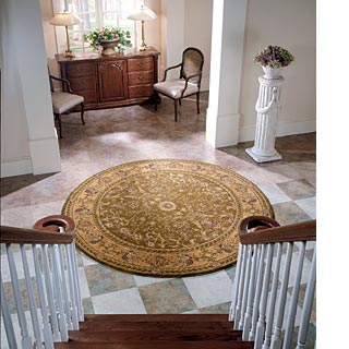 A round area rug can bring visual interest to an otherwise boring area.