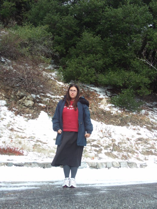 Picture of me by a snowy hillside.