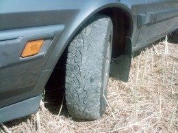 "You can see the wear on the outside of this tyre. This indicates that the cars wheels are pointing in at the front, or ""toed in"" Under brakes the car will spin around backwards!"