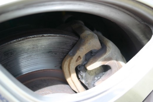 This brake rotor has been very hot, and has been run with a worn out brake pad. The metal has been damaged!
