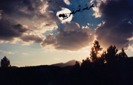 Santa flying over Sierra Blanca