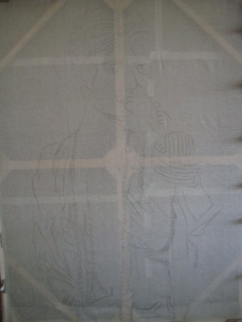 Make stretcher bars, the same kind used for canvas paintings, and gently stretch the fabric and clip it in place.  You can see the light charcoal drawing on this image.