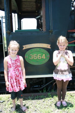 Rachael and Caitlin in front of one of the engines