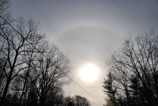 Halos are common sights around the sun and moon and are created by light passing through six-sided ice crystals in the atmosphere.