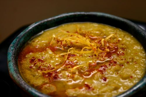 split pea soup drizzled with olive oil, sprinkled with paprika, and topped with lemon zest