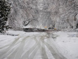 Icy roads make it difficult for power crews to make necessary repairs.
