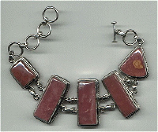 Rhodochrosite Bracelet with stones bezel mounted in sterling silver.