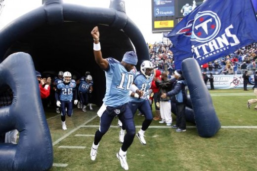 Tennessee Titans quarterback Vince Young (10) runs onto the field before the start of an NFL football game against the Miami Dolphins on Sunday, Dec. 20, 2009 in Nashville, Tenn. (AP Photo/Wade Payne)