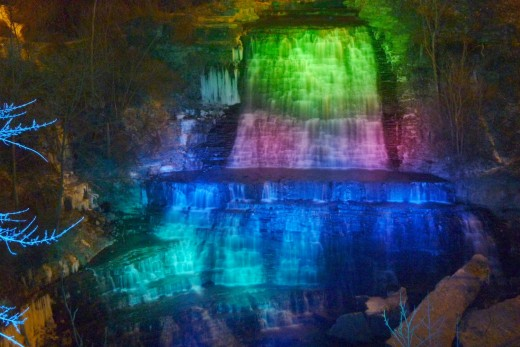 Albion Falls at night under colored spotlights.