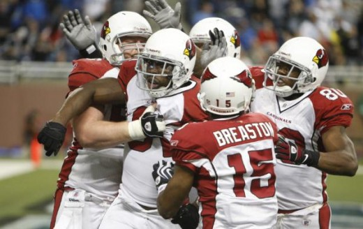 Arizona Cardinals wide receiver Anquan Boldin, second from left, is congratulated by teammates after scoring a touchdown to defeat the Detroit Lions in the closing minutes during an NFL football game at Ford Field in Detroit, Sunday, Dec. 20, 2009. (