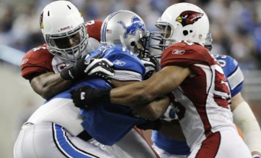 Sacked by Adrian Wilson and Clark Haggans in Detroit, Sunday, Dec. 20, 2009. (AP Photo/Paul Sancya)