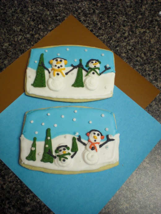 sugar cookies with snow men in royal icing