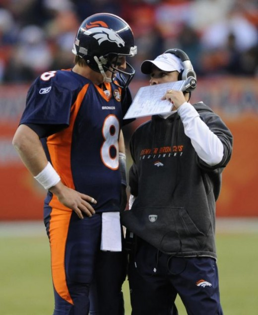 Josh McDaniels talks with Kyle Orton (AP Photo/Chris Schneider)