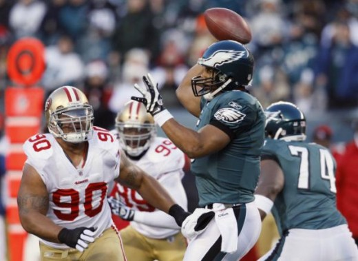 Philadelphia Eagles' Donovan McNabb, right foreground, passes in the first half of an NFL football game against the San Francisco 49ers, Sunday, Dec. 20, 2009, in Philadelphia. (AP Photo/Matt Slocum)