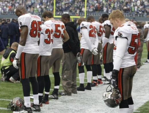 A moment of silence before the NFL football game against the Seattle Seahawks, in honor of Cincinati Bengals receiver Chris Henry who died this past week, Sunday, Dec. 20, 2009, in Seattle. (AP Photo/Ted S. Warren)