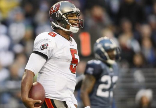 Tampa Bay Buccaneers quarterback Josh Freeman reacts after scoring against the Seattle Seahawks, during an NFL football game, Sunday, Dec. 20, 2009, in Seattle. (AP Photo/John Froschauer)