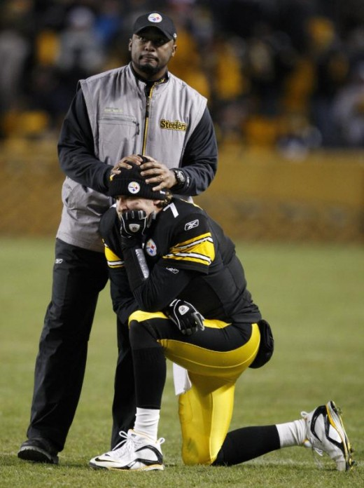 And they wait for the results of an official review of a Steelers touchdown at the end of the fourth quarter of NFL football against the Green Bay Packers Sunday, Dec. 20, 2009 in Pittsburgh. (AP Photo/Gene Puskar)