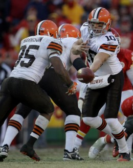 Brady Quinn (10) hands the ball to running back Jerome Harrison (35)during the fourth quarter of an NFL football game against the Kansas City Chiefs Sunday, Dec. 20, 2009 in Kansas City, Mo. The Browns won the game 41-34. (AP Photo/Charlie Riedel)