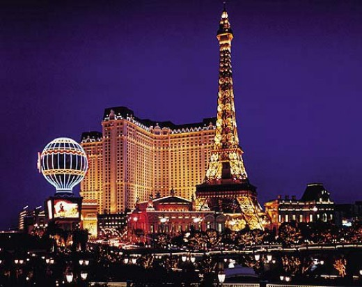 ...11 stories high in the Paris Hotel's replica of the Eiffel Tower