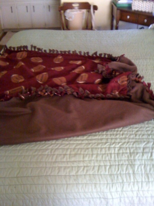 Notice the ties reflect the opposite pattern on each side of the blanket.  The brown shows the print and so on.