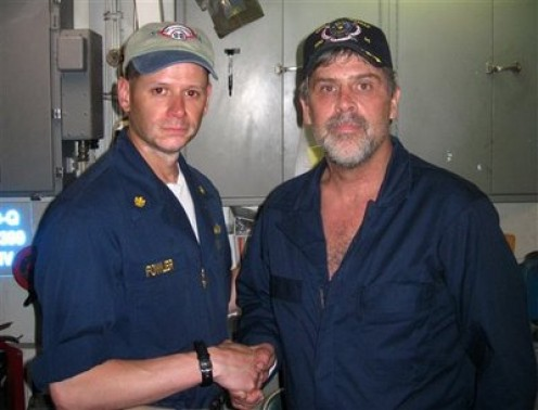 Maersk-Alabama Capt. Richard Phillips, right, shakes hands with Lt. Cmdr. David Fowler, executive officer of USS Bainbridge after being rescued by U.S Naval Forces, April 12, 2009.