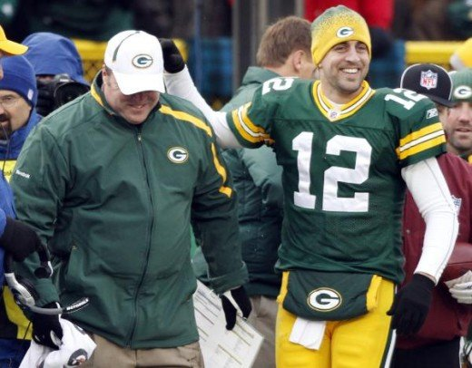 Mike McCarthy smiles with quarterback Aaron Rodgers (12) during the second half of an NFL football game against the Seattle Seahawks on Sunday, Dec. 27, 2009, in Green Bay, Wis. The Packers won 48-10. (AP Photo/Jim Prisching)