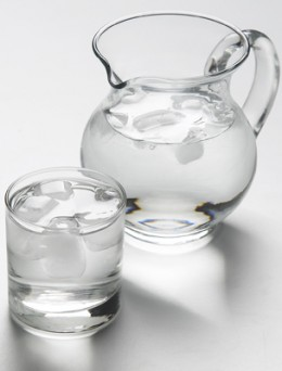 Sip water between alcoholic drinks for hangover prevention.