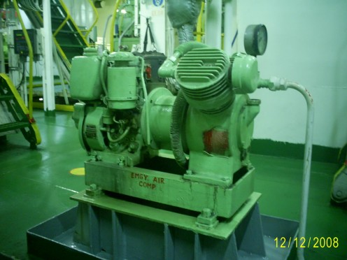 A reciprocating air compressor driven by diesel engine