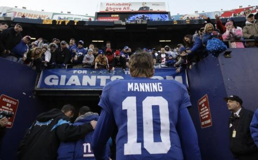 New York Giants quarterback Eli Manning (10) walks off the field after an NFL football game against the Carolina Panthers at Giants Stadium in East Rutherford, N.J., Sunday, Dec. 27, 2009. The Panthers won the game 41-9. (AP Photo/Julie Jacobson)