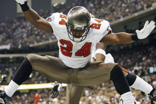 Tampa Bay Buccaneers running back Cadillac Williams (24) celebrates his touchdown against the New Orleans Saints in the second half of an NFL football game in New Orleans, Sunday, Dec. 27, 2009. (AP Photo/Gerald Herbert)