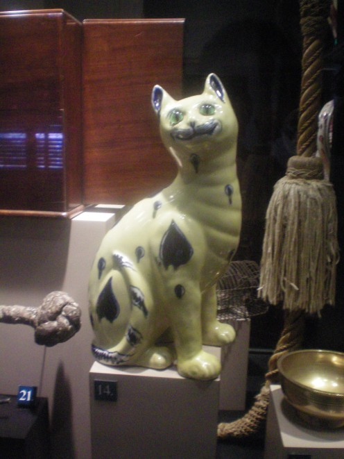 The Ceramic Cat. This Cat's Eyes Are Green - So You Know What That Means.