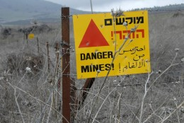 Minefields are still a danger many years after the war. Israel claims Syria left the bombs; Syria claims Israel did. You can see the Sea of Galilee in the background.