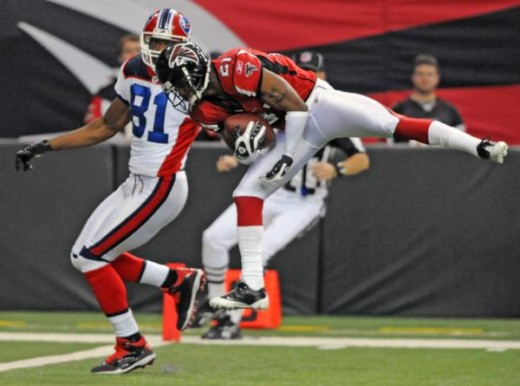 Atlanta Falcons' Chris Owens, right, intercepts a pass intended for Buffalo Bills' Terrell Owens, left, in the second quarter of an NFL football game on Sunday, Dec. 27, 2009, in Atlanta. (AP Photo/Erik S. Lesser)