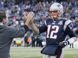 Brady gets a highfive from Bill Belicheck (AP Photo/Elise Amendola)