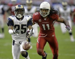 Arizona Cardinals wide receiver Larry Fitzgerald (11) and St. Louis Rams cornerback Danny Gorrer can't make a catch during the first half of an NFL football game Sunday, Dec. 27, 2009 in Glendale, Ariz. (AP Photo/Paul Connors)