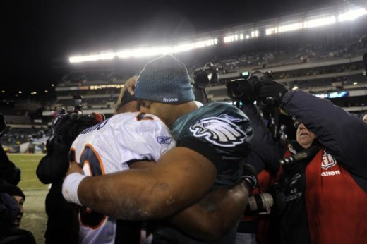 Philadelphia Eagles' Donovan McNabb, right, embraces Denver Broncos' Brian Dawkins after an NFL football game, Sunday, Dec. 27, 2009, in Philadelphia. Philadelphia won 30-27. (AP Photo/Michael Perez)