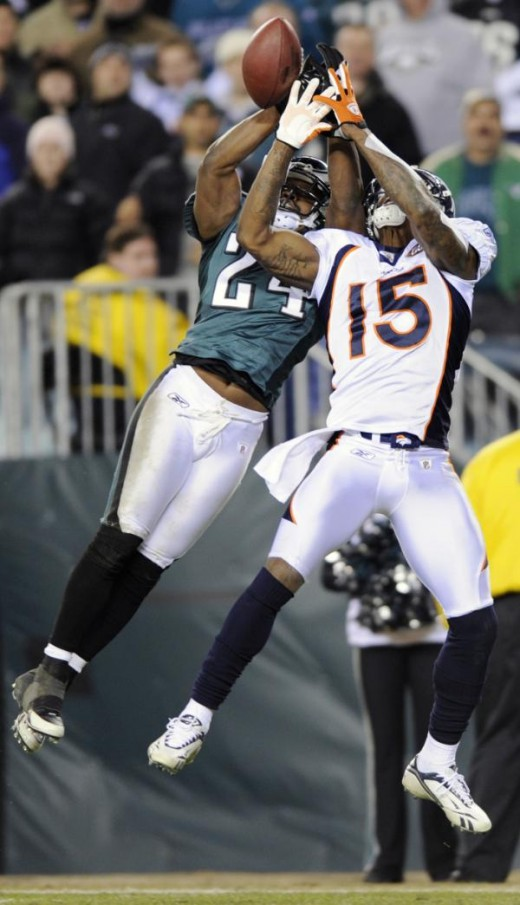 Philadelphia Eagles' Sheldon Brown, left, breaks up a pass intended for Denver Broncos' Brandon Marshall in the second half of an NFL football game, Sunday, Dec. 27, 2009, in Philadelphia. Philadelphia won 30-27. (AP Photo/Michael Perez)