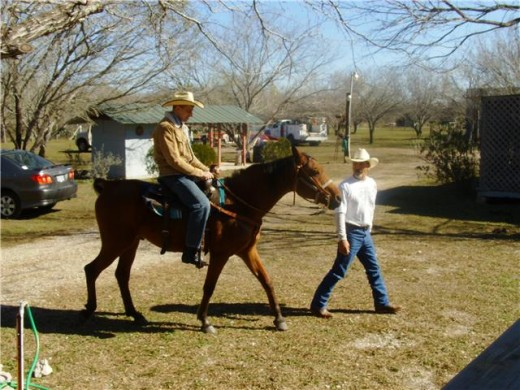 My husband and brother-in-law, the horse kept following his owner.